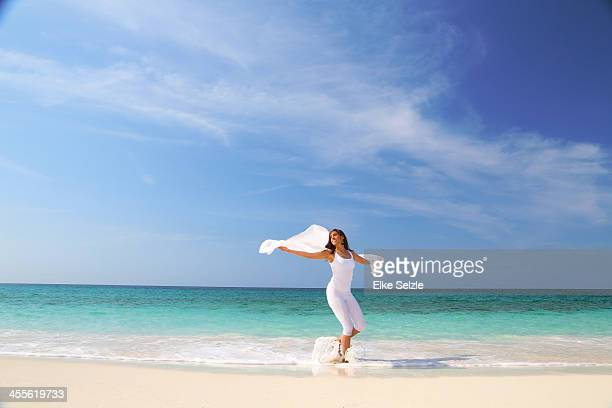 Woman dancing on the beach