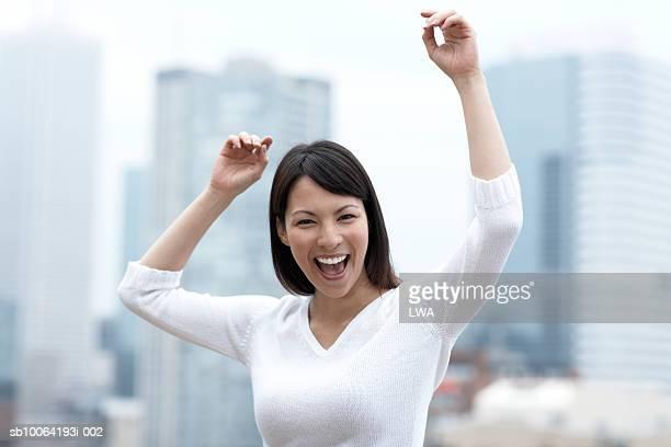 Woman dancing outdoor, laughing