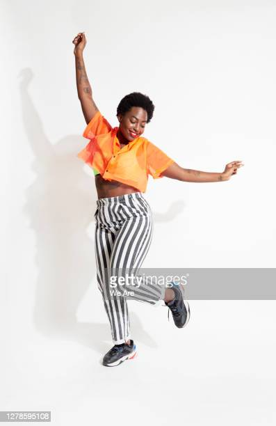 woman dancing - dancing stock pictures, royalty-free photos & images