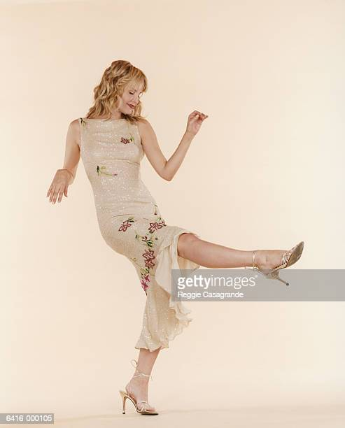 woman dancing - gold dress stock pictures, royalty-free photos & images