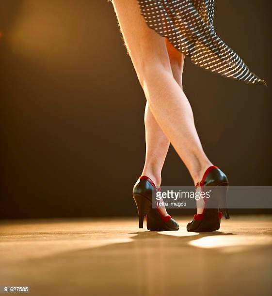 a woman dancing - salsa dancing stock photos and pictures