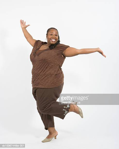 woman dancing, portrait - images of fat black women stock photos and pictures