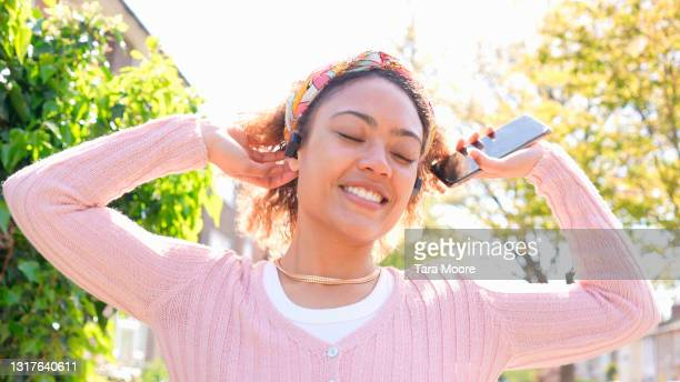 woman dancing to music outside - human limb stock pictures, royalty-free photos & images