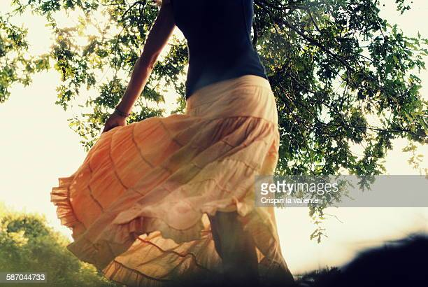 woman dancing under a tree - under the skirt stock photos and pictures