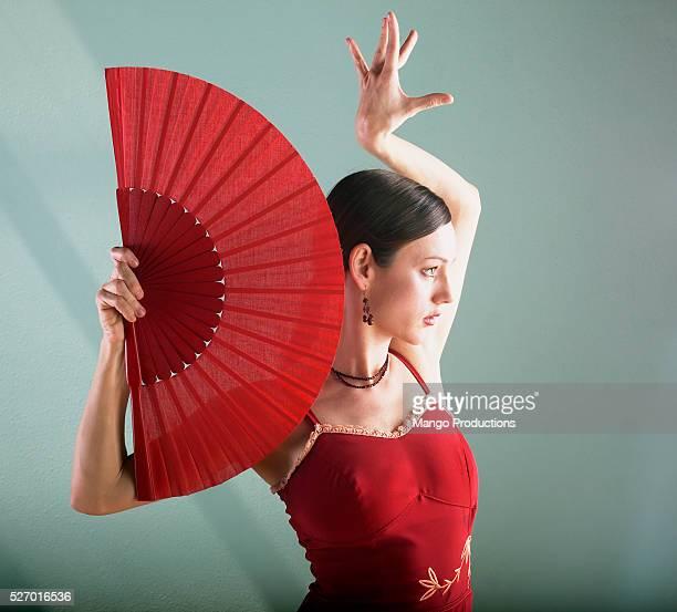 woman dancing with fan - ラテン音楽 ストックフォトと画像