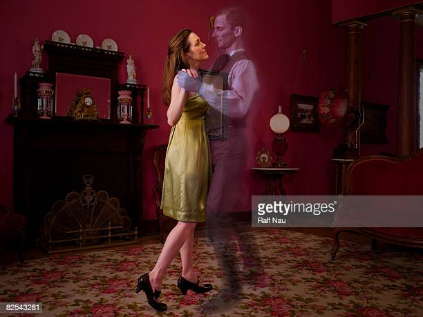 Woman dancing with ghost