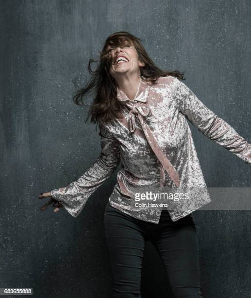 woman dancing with hair falling over face - gray pants stock pictures, royalty-free photos & images