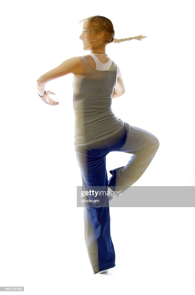 Woman dancing with movement blur : Stock Photo
