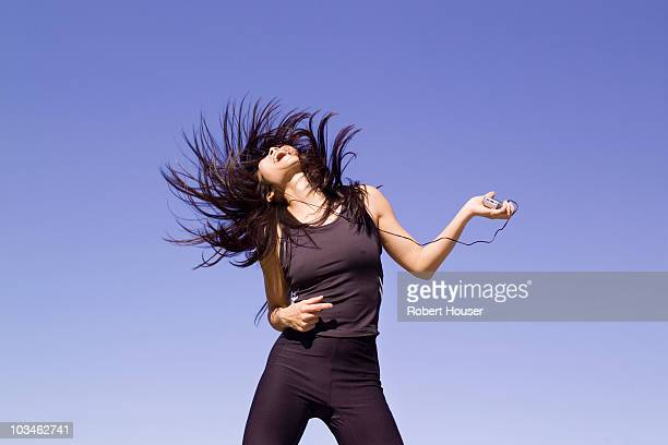 Woman Dancing with portable music device