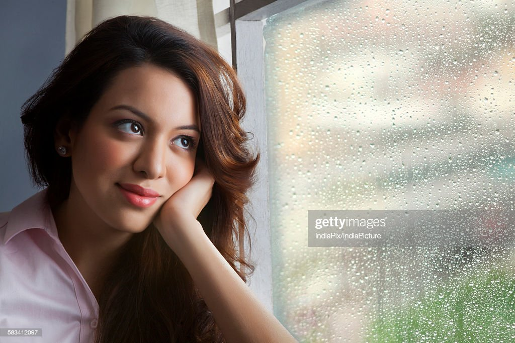 Woman day dreaming : Stock Photo