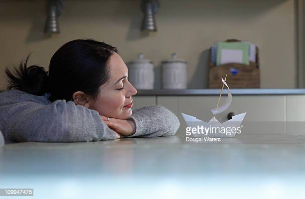 Woman daydreaming in kitchen