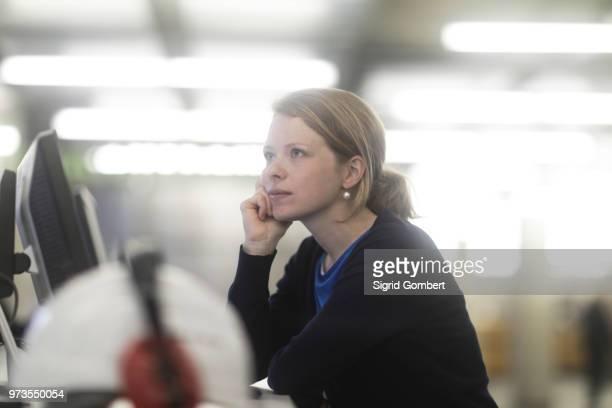 woman daydreaming in office - sigrid gombert fotografías e imágenes de stock