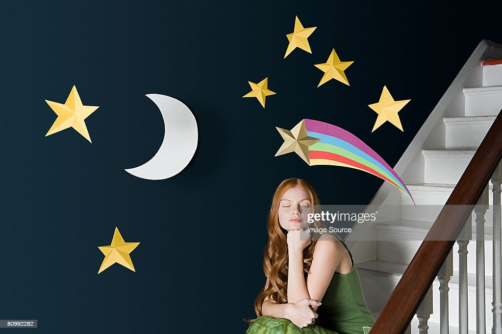 A woman daydreaming : Stock Photo