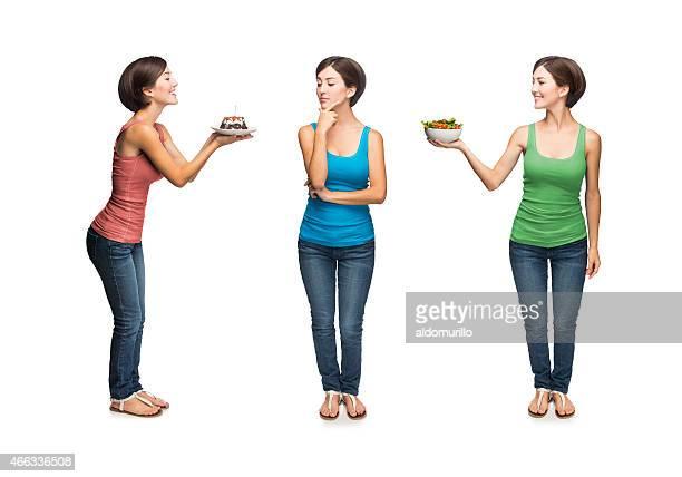 Woman deciding between cake or salad