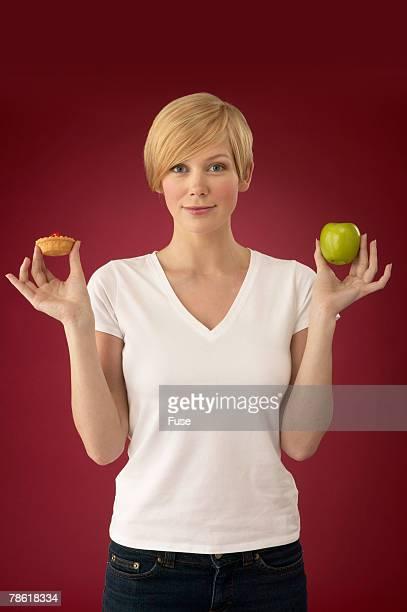 Woman Deciding Between Healthy or Unhealthy Food