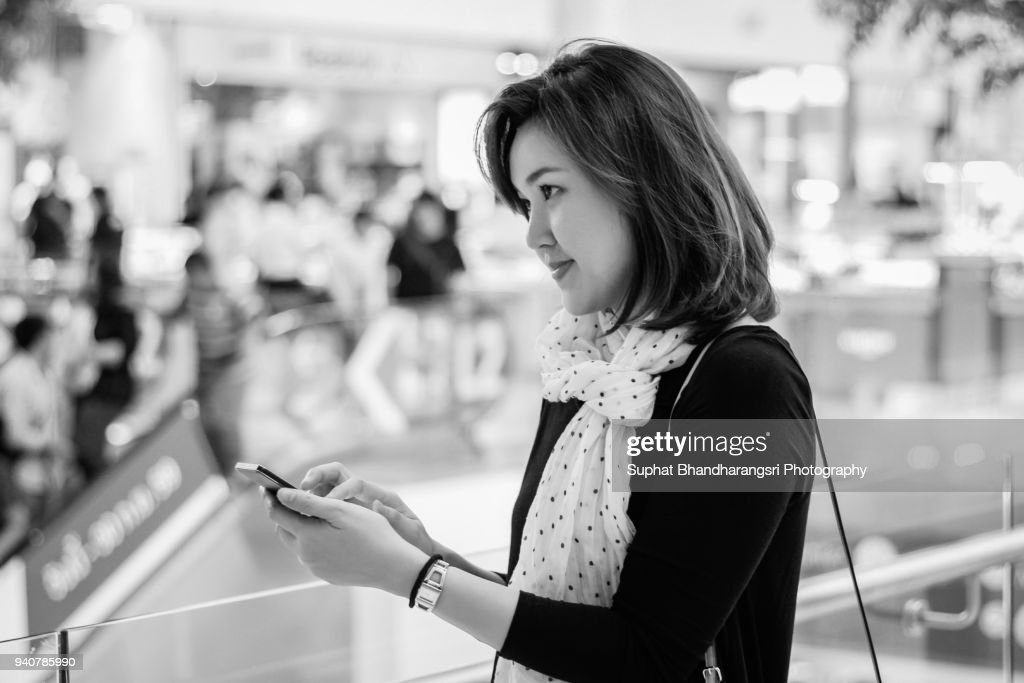 Woman deciding what to reply a message on smart phone : Stock Photo