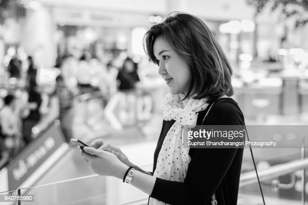 Woman deciding what to reply a message on smart phone