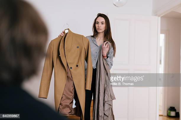 Woman deciding which Jacket to Wear