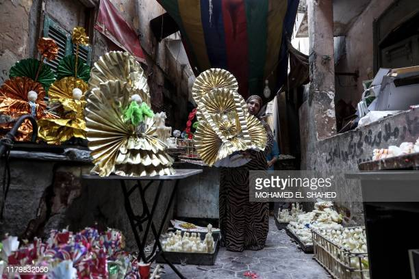 A woman decorates traditional sugar candy at a market in the capital Cairo on November 02 ahead of celebrations of the birthday of Prophet Mohammed...