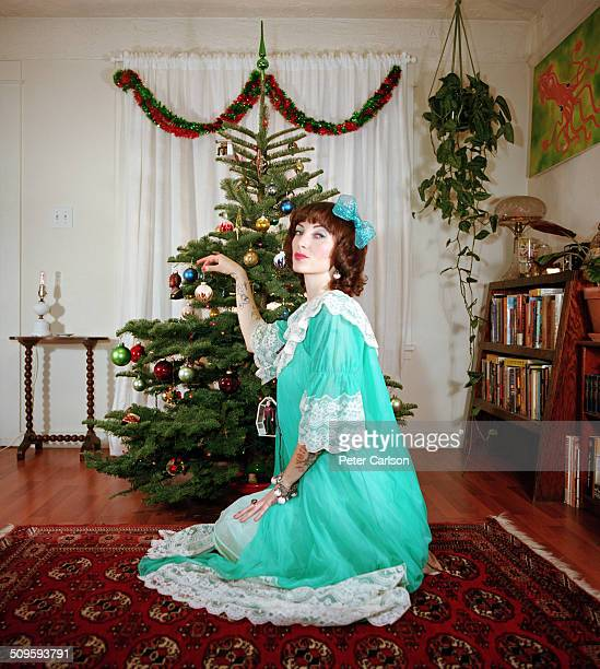 woman decorating a christmas tree - nightdress stock pictures, royalty-free photos & images