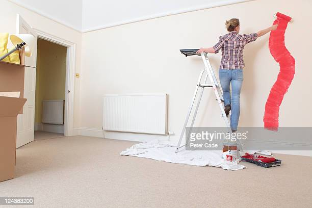 Woman decorating a new home.