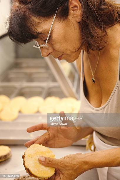 Woman decorating alfajores, Argentinian pastry