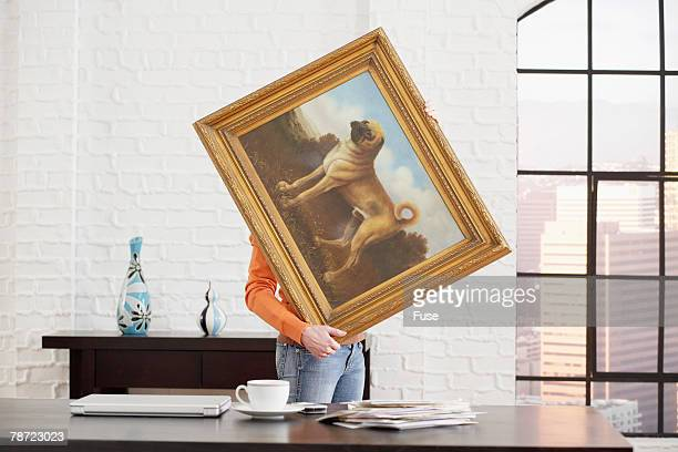 Woman Decorating Her Office