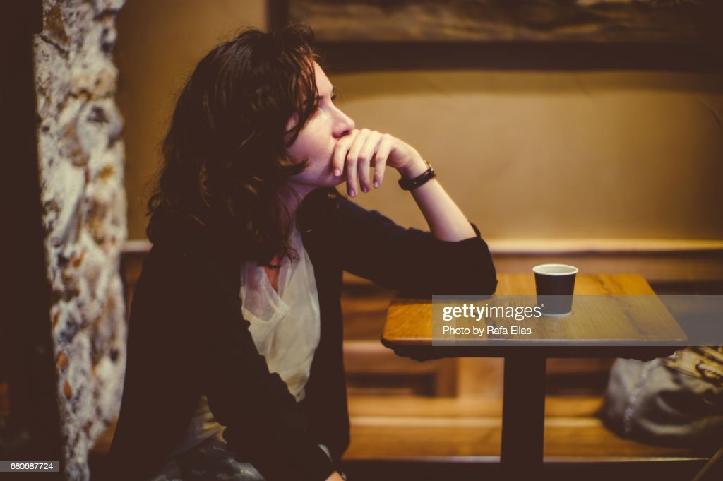 Woman deep in thought at the bar : Stock Photo