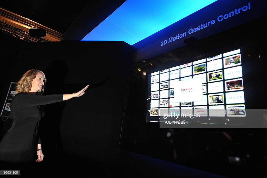 A woman demonstrates 3D motion gesture c : News Photo