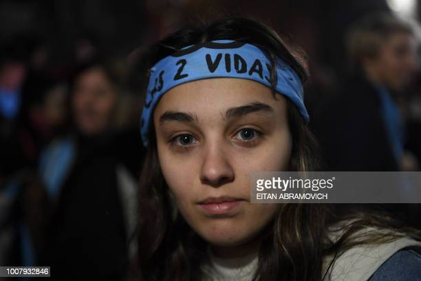 A woman demonstrates against the legalization of abortion in front of the presidential residence in Olivos Buenos Aires on July 30 2018 A...