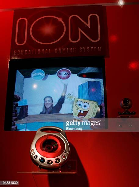 A woman demonstrates an ION educational gaming system in the Hasbro showroom of the American International Toy Fair in New York on February 18 2005...