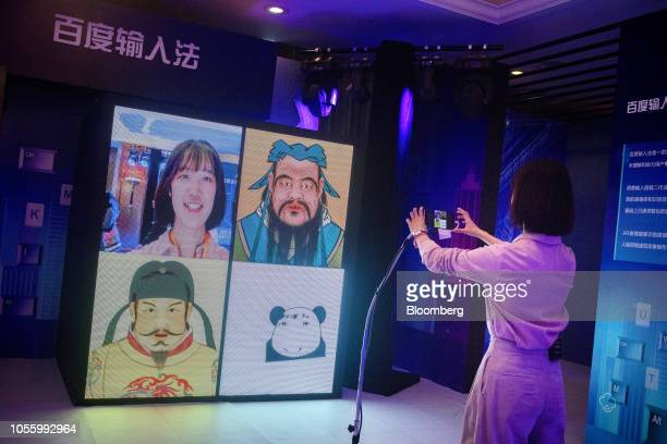 A woman demonstrates Baidu Inc's facial recognition system in an exhibition display at the Baidu World conference in Beijing China on Thursday Nov 1...
