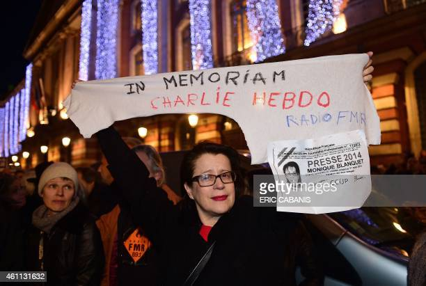 A woman demonstrates in Toulouse on January 7 in support to the victims of the attack by unknown gunmen on the offices of the satirical weekly...