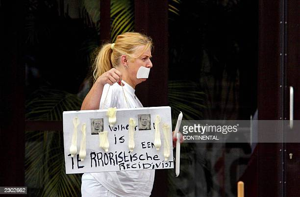 A woman demonstrates outside AmsterdamOsdorp courthouse where the prosecutor asked for the death penalty in the case against Pim Fortuyn's killer...