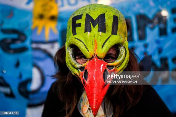 A woman demonstrates while legislators debate a bill to put a stop on public services taxes raising in Buenos Aires on May 09 2018 Argentina opened...