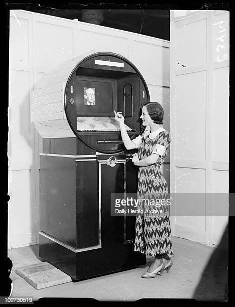 Woman demonstrating a futuristic radio set Radiolympia London 1933 A photograph of a woman demonstrating a 'radio set of the future' during the...