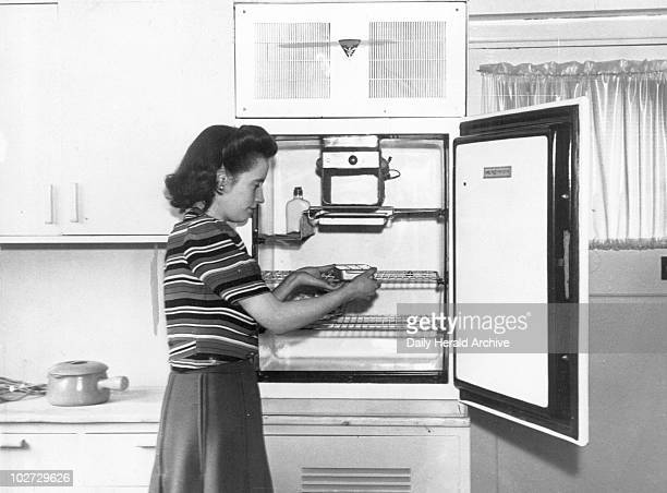 Woman demonstrating the latest refrigerator 1946 Woman demonstrating the latest refrigerator 20 June 1946 'Two Gibson demonstration houses opened at...