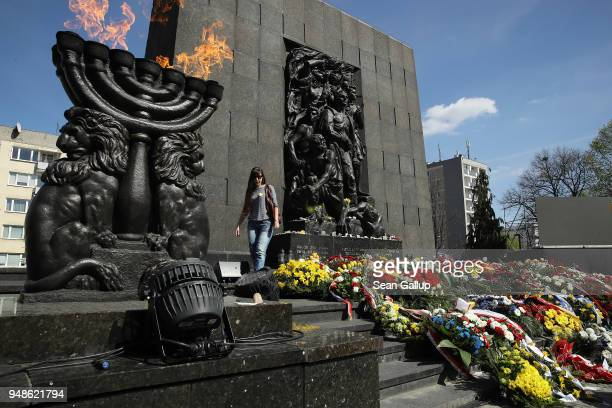 A woman descend after laying a candle at the Ghetto Heroes Monument following the main commemoration ceremony of the 75th anniversary of the Warsaw...