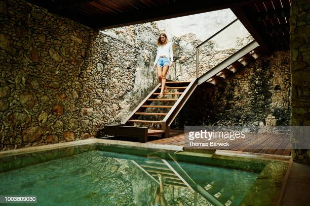 Woman descending stairs to spa at luxury resort