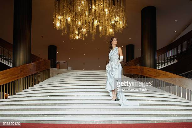 woman descending stairwell - evening gown stock pictures, royalty-free photos & images