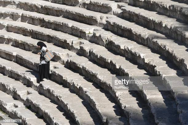 A woman descends steps of the 2ndcentury Roman theatre a famous landmark in the Jordanian capital located in the Old Town On Saturday February 2 in...