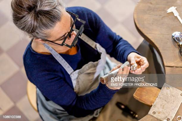 woman designer sitting in her manufacture workshop and making jewelry - pearl jewellery stock pictures, royalty-free photos & images