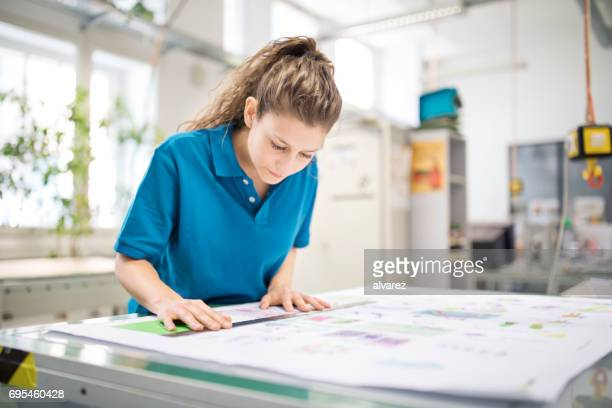 Woman designer working at printing factory