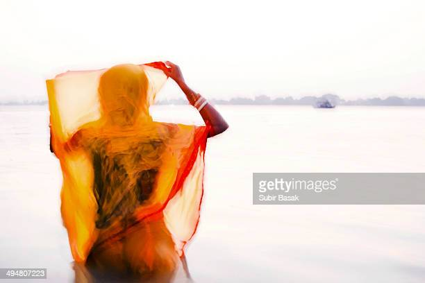 Woman devotees taking holy bath at Ganga river