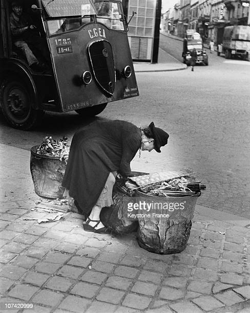 Woman Digging Into Waste Bins To Find Something To Eat In Paris On 1940 During 1944