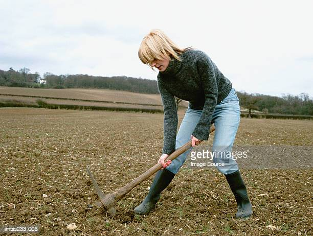 A woman digging the soil