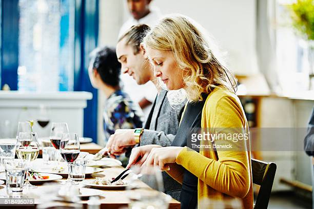 Woman dining with husband and friends