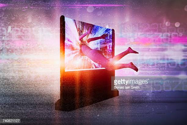 Woman disappearing into television