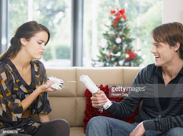 Woman disappointed by short end of Christmas cracker
