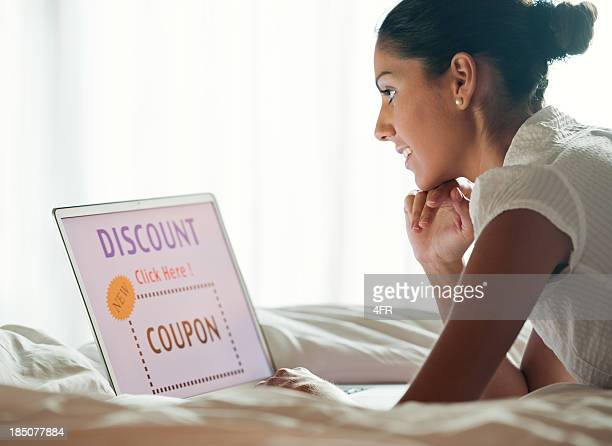 woman discount shopping in bed (xxxl) - coupon stock photos and pictures